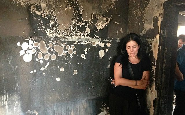 Tali Mizrahi, a member of the anti-racism group Light Tag, Tag Meir, visiting the home of a Palestinian baby allegedly killed by Jewish arsonists. (Ben Sales/JTA)