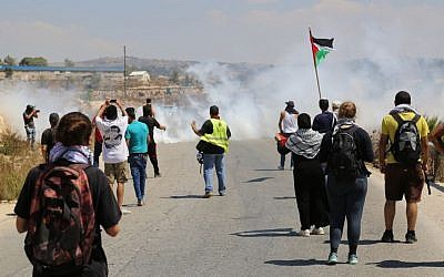 Demonstrators in the West Bank village of Nabi Saleh are met with tear gas after throwing stones at IDF soldiers (Eric Cortellessa/Times of Israel)
