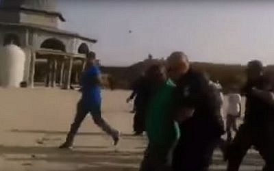 A French tourist being led off the Temple Mount on August 4, 2015 (Screen capture: YouTube)