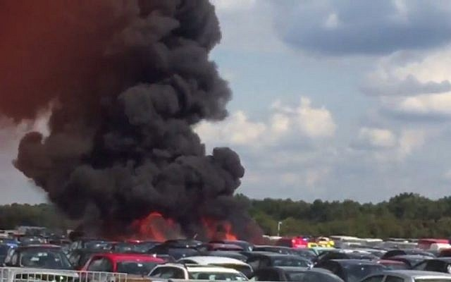Smoke rises from the site of a plane crash in the UK on July 31, 2015, in which members of the bin Laden family were killed. (screen capture: BBC)