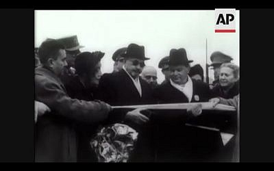 In this screenshot, Chaim Weizmann cuts a tape to symbolize his official entrance into Jerusalem for his inauguration as president (Photo courtesy AP)