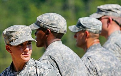 US Army Captain Kristen Griest, of Orange, Connecticut, left, smiles as she stands in formation during an Army Ranger School graduation ceremony, Friday, August 21, 2015, at Fort Benning, Georgia (AP/John Bazemore)