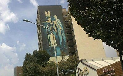 A billboard depicts US President Barack Obama standing next to Caliph Yazid I, the seventh century ruler responsible for the killing of Imam Hussein (Times of Israel staff