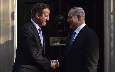 Britain's Prime Minister David Cameron, left, greets Prime Minister Benjamin Netanyahu outside 10 Downing Street ahead of a meeting in London, September 10, 2015. (AFP/Leon Neal)