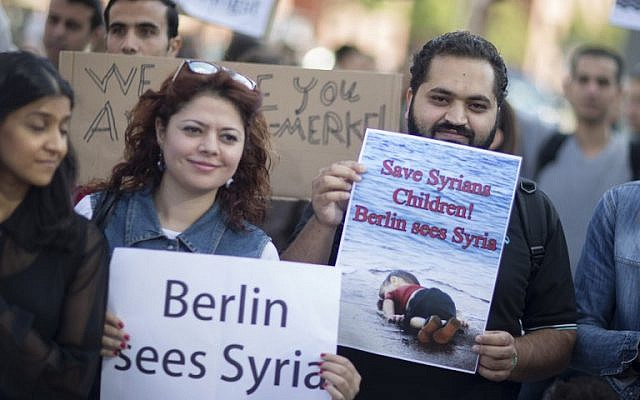 Participants at a pro-migrant demonstration in Berlin on September 12, 2015. (AFP PHOTO / AXEL SCHMIDT)