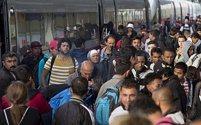 Refugees get out of a special train coming from Munich upon arrival at the railway station in Berlin Schoenefeld on September 13, 2015. (Axel Schmidt/AFP)