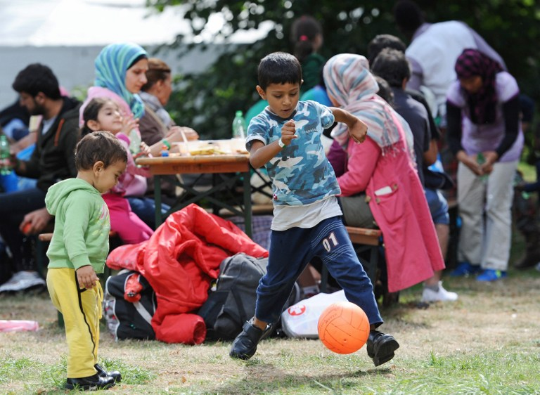 Migrant children play at a temporary camp for asylum-seekers near the main railway station in Munich, southern Germany, on September 13, 2015. (Andreas Gebert/DPA/AFP)