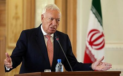 Spanish Foreign Affairs and Cooperation Minister Jose Garcia-Margallo speaks during a joint press conference with his Iranian counterpart Mohammad Javad Zarif (unseen) on September 7, 2015 in the Iranian capital, Tehran. (AFP Photo/Atta Kenare)