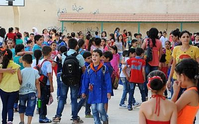 A handout picture released by the Syrian Arab News Agency (SANA) on September 13, 2015 shows Syrian children gathering in a playground on the first day of the new school year in the capital Damascus. The Organizarion of Islamic Cooperation called on the UN to create a peacekeeping force that would stem the surge of Syrian refugees. (Ho/SANA/AFP)
