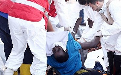 Members of the Libyan Red Crescent evacuate the bodies of illegal migrants after a Libyan oil tanker rescued a group of migrants off the coast of the Libyan capital Tripoli on September 18, 2015 at Tripoli's port. (AFP PHOTO/MAHMUD TURKIA)