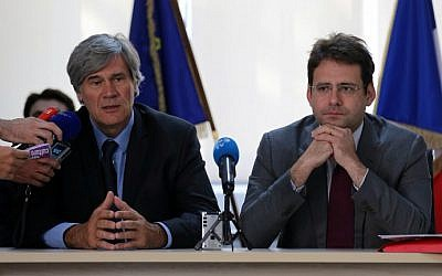 French Agriculture Minister Stephane Le Foll (left) and Junior Minister for Foreign Trade and Tourism Matthias Fekl speak to the press following the inauguration of a so-called  'Business France' agency in Tehran, September 21, 2015. (AFP/Atta Kenare)