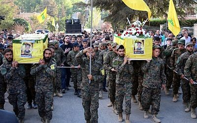 Hezbollah fighters carry the coffins of comrades who were killed in battles in Syria during their funeral on September 21, 2015 in the town of Baalbek in eastern Lebanon's Bekaa Valley. (AFP/STR)