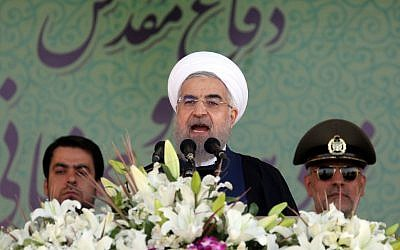Iranian President Hassan Rouhani delivers a speech  on September 22, 2015, in the capital Tehran.  (AFP/ATTA KENARE)