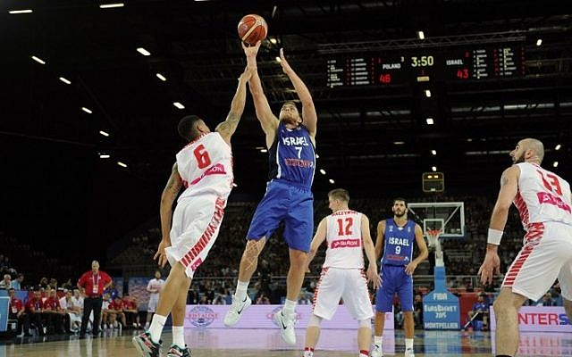 Israel's Gal Mekel (center) takes a shot during the Group A qualifying basketball match between Poland and Israel at the EuroBasket 2015 in Montpellier, France, on September 9, 2015. (AFP/Sylvain Thomas)