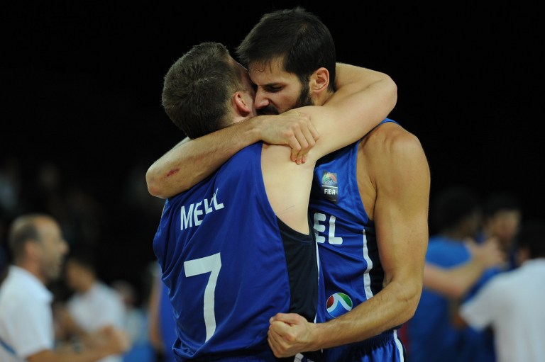 Israel's Gal Mekel Omri Casspi celebrate after their team won the group A qualifying basketball match between Poland and Israel at the EuroBasket 2015 in Montpellier on September 9, 2015.  (Sylvain Thomas/AFP)