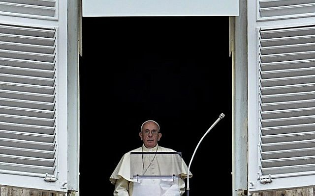 Pope Francis delivers his speech to the faithful from the window of his apartment during his Sunday Angelus prayer in St. Peter's Square at the Vatican on September 13, 2015. (AFP Photo/Andreas Solaro)
