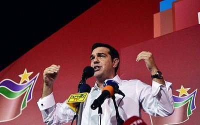 Greece's Syriza party leader Alexis Tsipras speaks with supporters after his party's victory in the Greek general elections at his campaign headquarters in Athens on September 20, 2015. (AFP Photo/Louisa Gouliamaki)