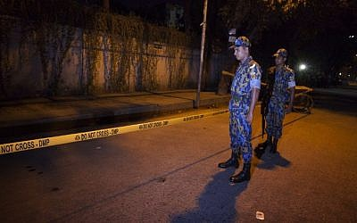 Bangladeshi police officers stand guard on September 28, 2015 at the site where an Italian charity worker has died after being shot by attackers in Dhaka. (AFP)