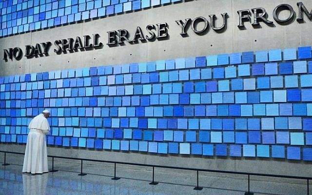 """Pope Francis visits the 9/11 Memorial Museum in New York City on September 25, 2015 and prays at """"Trying to Remember the Color of the Sky on That September Morning"""" by Spencer Finch. Reposed behind this blue wall are the remains of many who perished at the World Trade Center site on September 11, 2001 (AFP/POOL/Susan Watts)"""