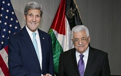 US Secretary of State John Kerry meets with Palestinian President Mahmoud Abbas at the Grand Hyatt Hotel in New York on September 26, 2015. (AFP/Dominick Reuter)