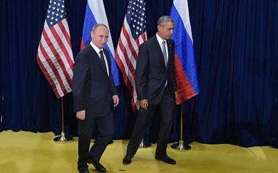 US President Barack Obama and Russia's President Vladimir Putin leave after posing for a photo ahead of a bilateral meeting on the sidelines of the 70th session of the UN General Assembly at the United Nations headquarters on September 28, 2015 in New York. (AFP/MANDEL NGAN)