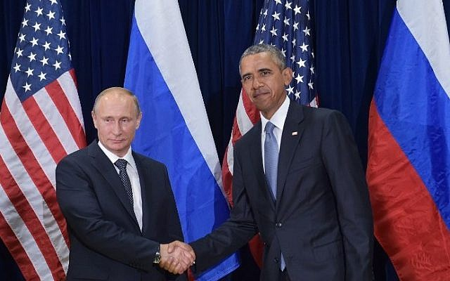 US President Barack Obama and Russia's President Vladimir Putin shake hands while posing for a photo ahead of a bilateral meeting on the sidelines of the 70th session of the UN General Assembly at the United Nations headquarters on September 28, 2015 in New York. (Mandel Ngan/AFP)