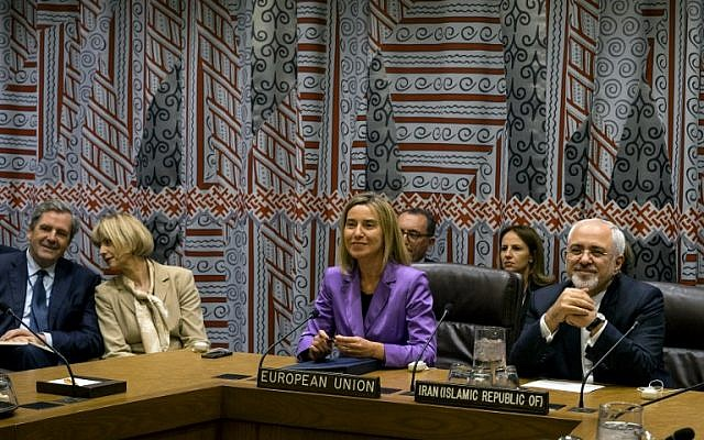 European Union High Representative For Foreign Affairs and Security Policy Federica Mogherini (C) and Iran's Foreign Minister Mohammad Javad Zarif attend a P5+1+EU+Iran meeting during the 70th session of the United Nations General Assembly in New York on September 28, 2015. (AFP PHOTO/POOL/CRAIG RUTTLE)