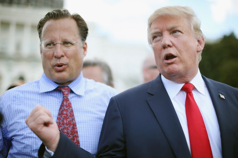 Rep. Dave Brat (R-VA) (L) reacts as Republican presidential candidate Donald Trump says it would be 'the end of his political career' if Brat does not support Trump for president during a rally against the Iran nuclear deal on the West Lawn of the U.S. Capitol September 9, 2015 in Washington, DC. (Chip Somodevilla/Getty Images/AFP)