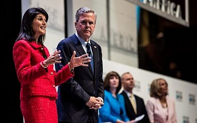 South Carolina Governor Nikki Haley (left) talks about education with former Florida Governor and republican presidential candidate Jeb Bush at the Heritage Action Presidential Candidate Forum September 18, 2015 in Greenville, South Carolina. (Sean Rayford/Getty Images/AFP)