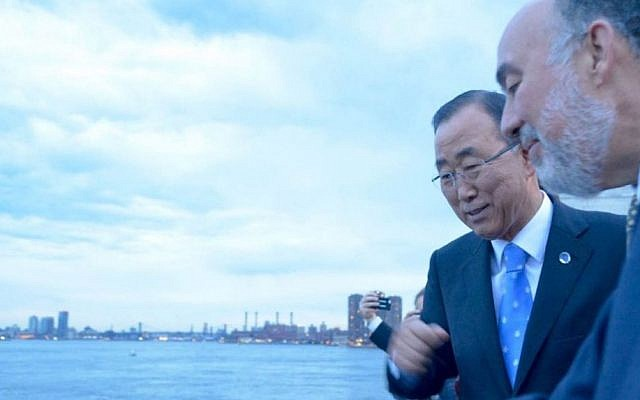 UN chief Ban Ki-moon, left, and Israeli envoy Ron Prosor casting their sins into Turtle Bay on September 21, 2015. (Gemma Manalese)
