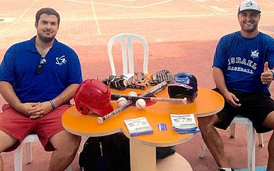 Nate Fish and Josh Scharff table at local Israeli schools to encourage youth to play baseball.