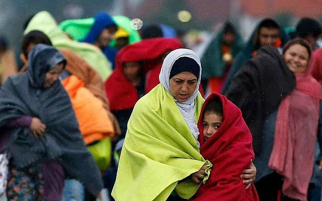 Migrants arrive at the Hungarian-Austrian border in Nickelsdorf, Austria, Saturday, Sept. 5, 2015, where they came from Budapest as Austria in the early-morning hours said it and Germany would let them in. (AP Photo/Frank Augstein)