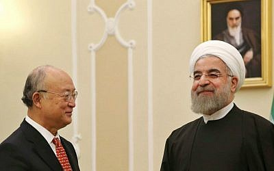 Iranian President Hassan Rouhani (right), welcomes UN nuclear chief Yukiya Amano for their meeting in Tehran, Iran, September 20, 2015. (AP/Vahid Salemi)