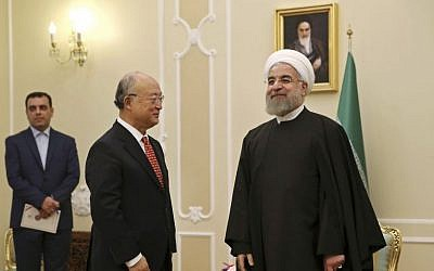 Iranian President Hassan Rouhani welcomes UN nuclear chief Yukiya Amano for their meeting in Tehran, Iran, Sunday, Sept. 20, 2015. (AP Photo/Vahid Salemi)