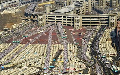 """In this image released by the Saudi Press Agency (SPA), hundreds of thousands of Muslim pilgrims make their way to cast stones at a pillar symbolizing the stoning of Satan in a ritual called """"Jamarat,"""" the last rite of the annual hajj, on the first day of Eid al-Adha, in Mina on the outskirts of the holy city of Mecca, Saudi Arabia, Thursday, Sept. 24, 2015. (Saudi Press Agency via AP)"""