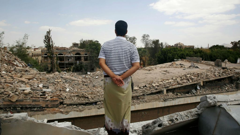 A man looks at the Houthi-controlled headquarters of the Yemeni army destroyed by Saudi-led airstrikes in Sanaa Yemen