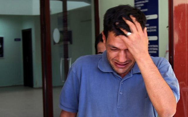 Abdullah Kurdi, 40, father of Syrian boys Aylan, 3, and Galip, 5, who were washed up on a beach near the Turkish resort of Bodrum on September 2, 2015, cries as he waits for the delivery of their bodies outside a morgue in Mugla, Turkey, on September 3, 2015. (AP/Mehmet Can Meral)