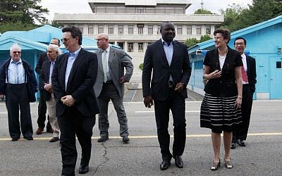 Comprehensive Nuclear Test Ban Treaty Organization Executive Secretary Lassina Zerbo, third from right, and the Eminent Persons Group members visit the border village of Panmunjom that separates the two Koreas in South Korea, June 26, 2015. (AP Photo/Ahn Young-joon)