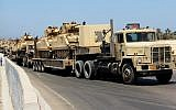 In this August 9, 2012, file photo, army trucks carry Egyptian tanks in a military convoy in El Arish, Egypt's northern Sinai Peninsula. (AP)