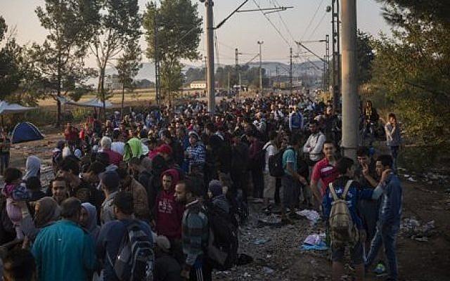 Illustrative: Syrian refugees wait near the border railway station of Idomeni, northern Greece, on August 25, 2015. (Santi Palacios/AP)