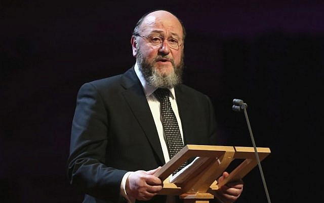 Illustrative: Chief Rabbi Ephraim Mirvis gives a speech as he attends a Holocaust Memorial Day Ceremony at Central Hall Westminster, January 27, 2015. (AP/Chris Jackson)