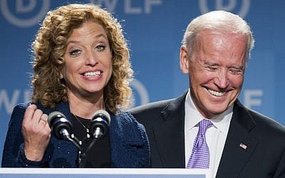 Vice President Joe Biden, right, laughs as he is introduced by DNC Chair Rep. Debbie Wasserman Schultz, D-Florida, at the DNC Women's Leadership conference in Washington, Friday, September 19, 2014. (AP/Manuel Balce Ceneta)