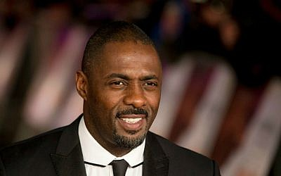 "In this file photo photo dated Thursday, Dec. 5, 2013, British actor Idris Elba, who plays Nelson Mandela in the movie ""Mandela: Long Walk to Freedom,"" poses for photographers in London. (AP Photo/Matt Dunham, File)"