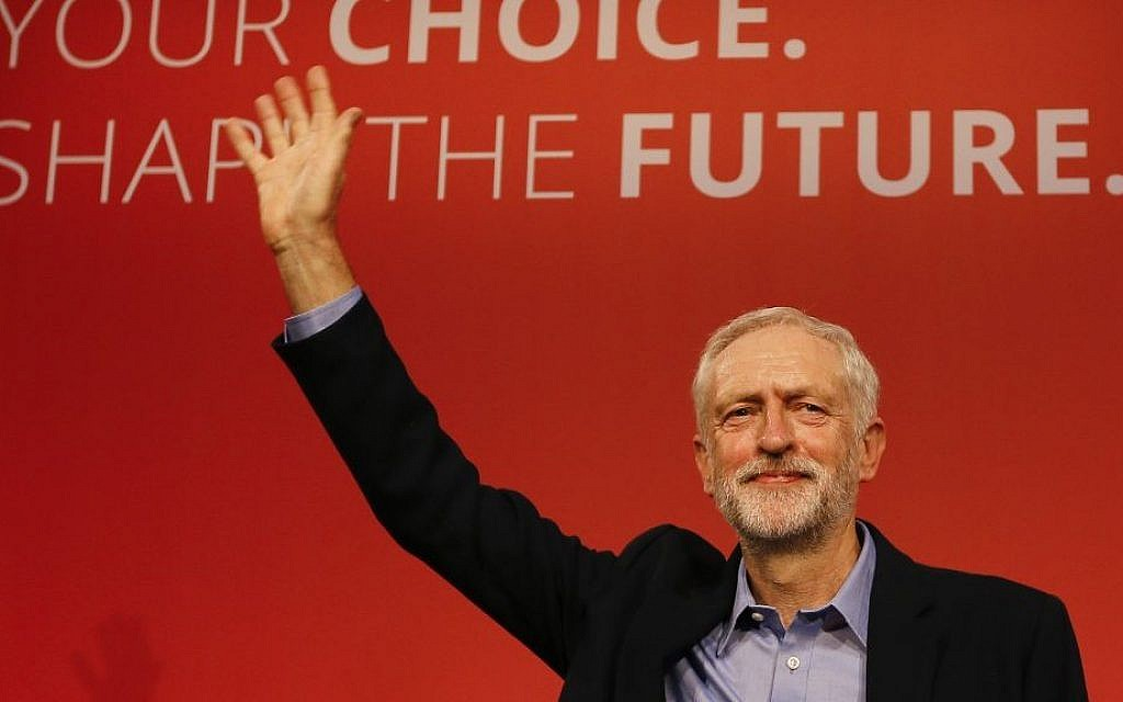 Jeremy Corbyn waves on stage after he is announced as the new leader of The Labour Party during the Labour Party Leadership Conference in London, Saturday, Sept. 12, 2015. (AP Photo/Kirsty Wigglesworth)