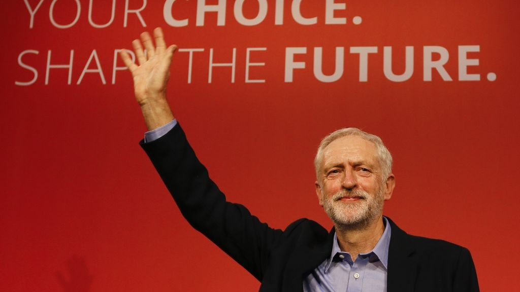 Jeremy Corbyn waves on stage after he is announced as the new leader of The Labour Party during the Labour Party Leadership Conference in London, Saturday, Sept. 12, 2015. Corbyn will now lead Britain's main opposition party. (AP Photo/Kirsty Wigglesworth)