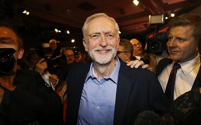 Jeremy Corbyn smiles as he leaves the stage after he is announced as the new leader of the UK opposition Labour Party during the Labour Party Leadership Conference in London, Saturday, Sept. 12, 2015. (AP/Kirsty Wigglesworth)