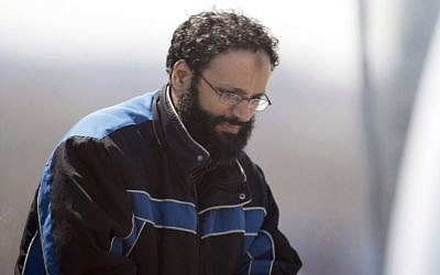 In this April 23, 2013, file photo, Chiheb Esseghaier, one of two suspects accused of plotting with al-Qaeda to derail a train in Canada, arrives at Buttonville Airport, north of Toronto. (Frank Gunn/The Canadian Press via AP, File)