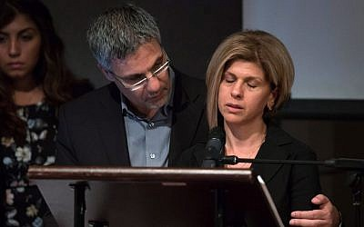 Tima Kurdi (right), aunt of the brothers Aylan and Ghalib Kurdi, who died as they fled with their family from Syria, is comforted by her husband Rocco Logozzo during a memorial service in Vancouver, Canada, on September 5, 2015. (Darryl Dyck/The Canadian Press via AP)