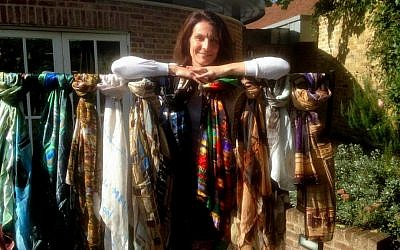 Celia Gould, the wife of Britain's former ambassador to Israel Matthew Gould, shows off her new collection of scarf designs in her UK home. (Jenni Frazer/The TImes of Israel)