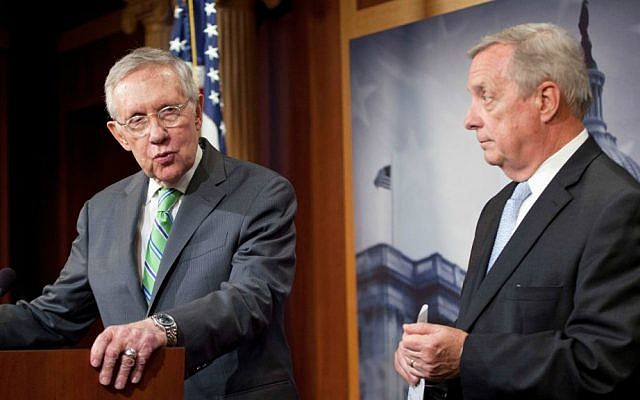 In this Sept. 10, 2015 file photo, Senate Minority Leader Harry Reid (D-Nevada), and Senate Minority Whip Richard Durbin (D-Illinois), participate in a news conference on Capitol Hill in Washington. (AP Photo/Pablo Martinez Monsivais, File)